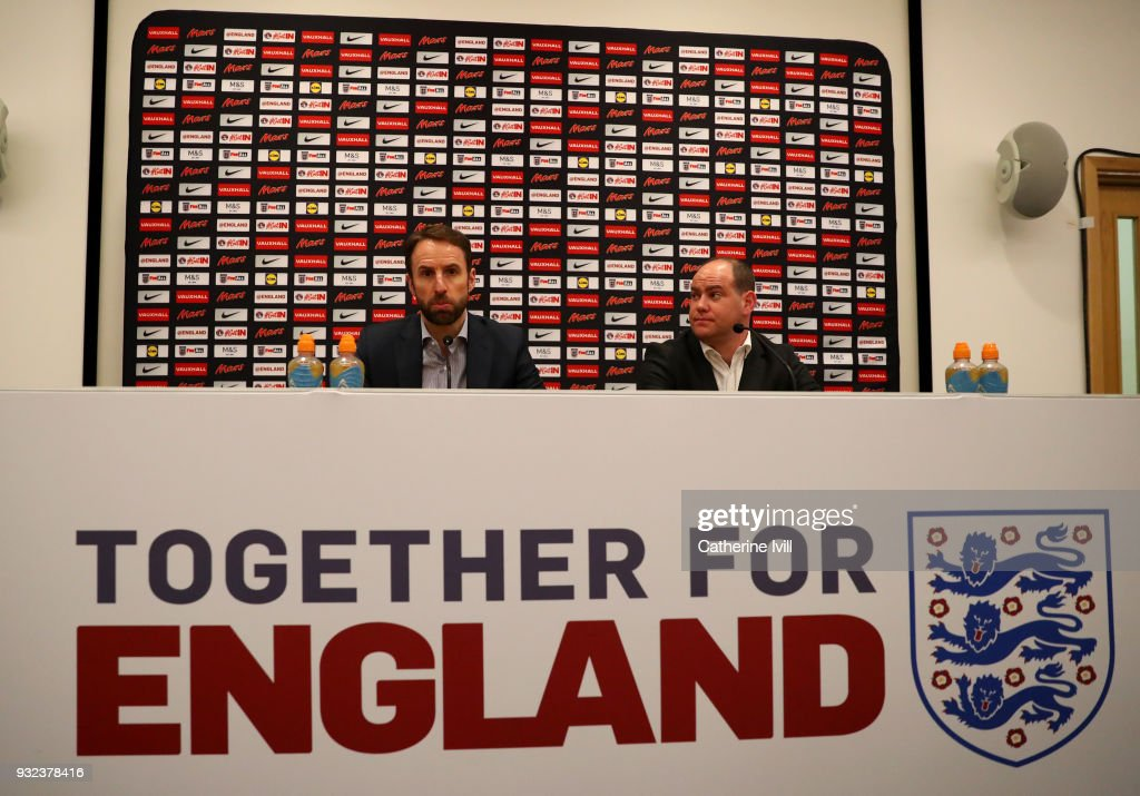 England manager Gareth Southgate speaks to the media alongside Robert Sullivan, director of strategy and communications during a press conference at St Georges Park on March 15, 2018 in Burton-upon-Trent, England.