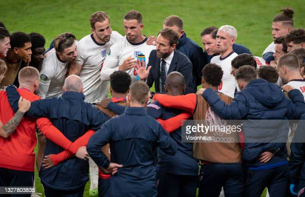 England manager Gareth Southgate talks to his players during the half time break of extra time during the UEFA Euro 2020 Championship Semi-final...