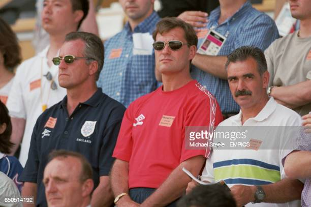 England manager Glenn Hoddle and his assistants Ray Clemence and John Gorman listen to the national anthems before watching the game
