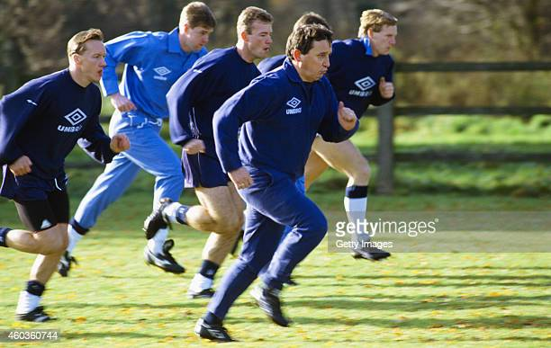 England manager Graham Taylor leads his players on a run Lee Dixon Gary Pallister Alan Shearer and Stuart Pearce during a training session circa 1992