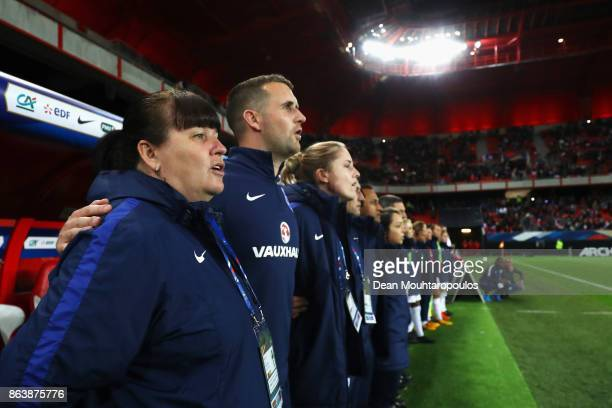 England Manager / Head coach Mo Marley sings the national anthem prior to the International friendly match between France and England held at Stade...
