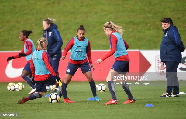 England manager Mo Marley watches Nikita Parris during the training session at St George's Park Burton