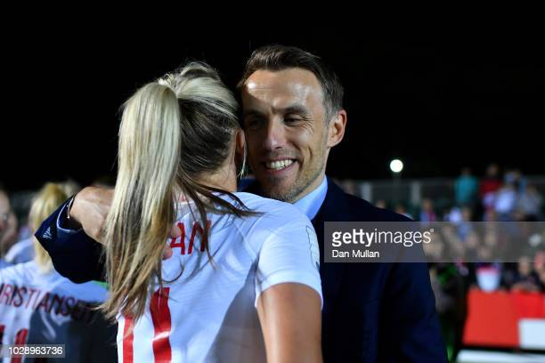 England manager Phil Neville and Toni Duggan of England celebrate victory at the final whistle during the Women's World Cup qualifier between Wales...