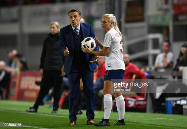 England manager Phil Neville gives instructions as Alex Greenwood of England looks on during the Women's World Cup qualifier between Wales Women and...