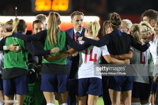 England manager Phil Neville speaks with the team after their win during the FIFA Women's World Cup Qualifier at Rodney Parade Stadium on August 31...