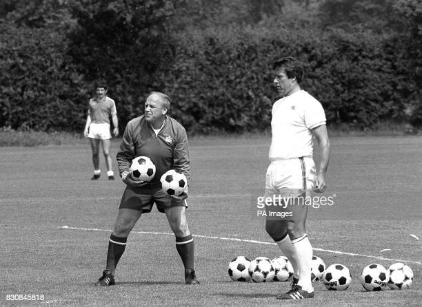 England manager Ron Greenwood and Geoff Hurst about to throw balls for kicks by defenders during England's training session for the World Cup series...