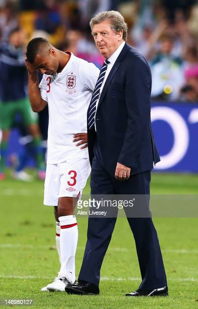 England manager, Roy Hodgson and Ashley Cole look dejected after the penalty shoot out during the UEFA EURO 2012 quarter final match between England...