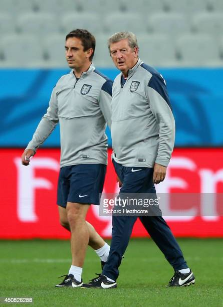England Manager Roy Hodgson and assistant coach Gary Neville look on during an England training session ahead of the 2014 FIFA World Cup Brazil match...