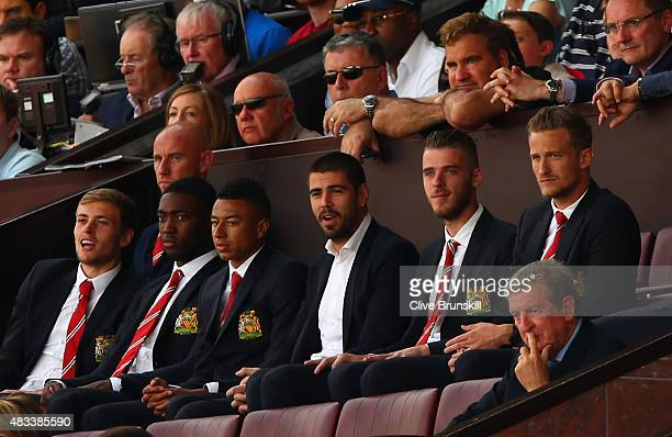 England manager Roy Hodgson and Manchester United players are see on the stand during the Barclays Premier League match between Manchester United and...