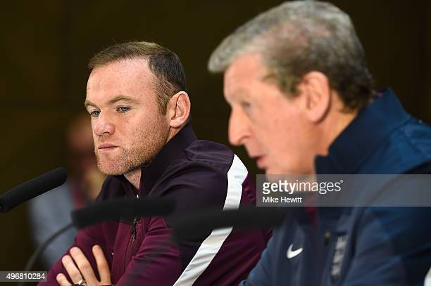 England manager Roy Hodgson faces the media as England captain Wayne Rooney looks on during an England press conference at the Asia Gardens hotel on...