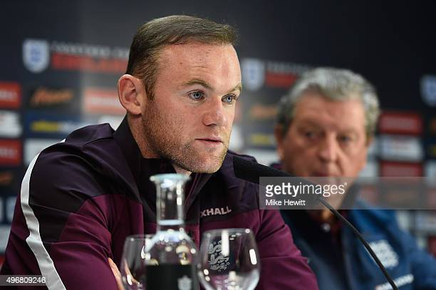 England manager Roy Hodgson looks on as England captain Wayne Rooney faces the media during an England press conference at the Asia Gardens hotel on...