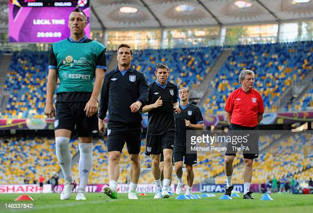 England manager Roy Hodgson looks on as John Terry, Scott Parker, James Milner and Andy Carroll warm during the England training session at the...