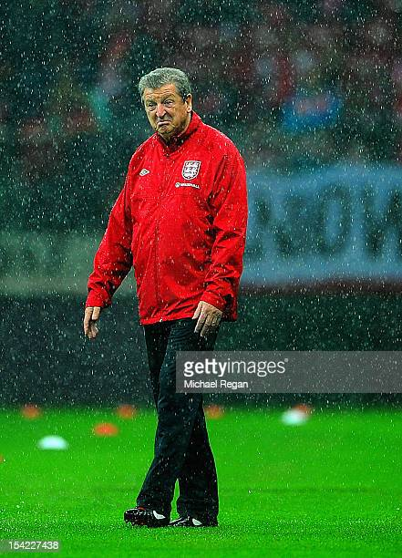 England manager Roy Hodgson looks on during the rain before the FIFA 2014 World Cup Qualifier between Poland and England at the National Stadium on...