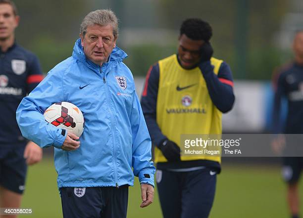 England manager Roy Hodgson looks on with Daniel Sturridge during the England training session at London Colney on November 18, 2013 in St Albans,...
