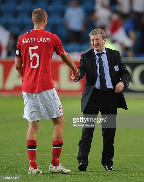 England manager Roy Hodgson speaks to Brede Hangeland of Norway during the international friendly match between Norway and England at the Ullevaal...