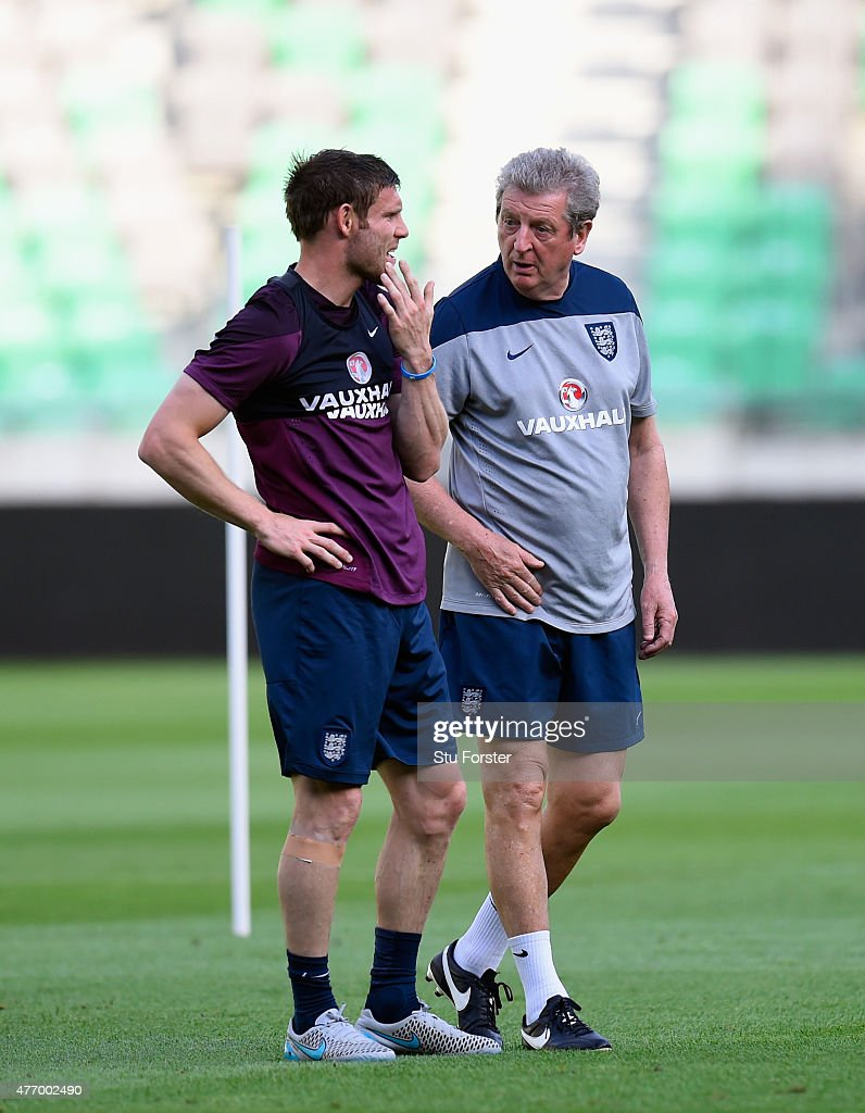 England manager Roy Hodgson (r) speaks to James Milner during England Training prior to sunday's UEFA EURO 2016 Qualifier between Slovenia and England at Stozice on June 13, 2015 in Ljubljana, Slovenia.