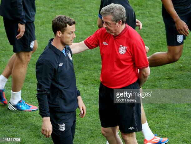England manager Roy Hodgson speaks to Scott Parker during a UEFA EURO 2012 training session at the Olympic Stadium on June 14, 2012 in Kiev, Ukraine.