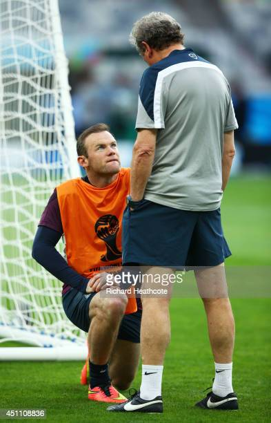England Manager Roy Hodgson speaks to Wayne Rooney during an England training session ahead of the 2014 FIFA World Cup Brazil Group D match against...
