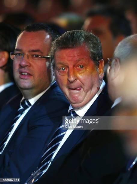 England manager Roy Hodgson speaks with FA Chairman Greg Dyke as FA General Secretary Alex Horne looks on during the Final Draw for the 2014 FIFA...