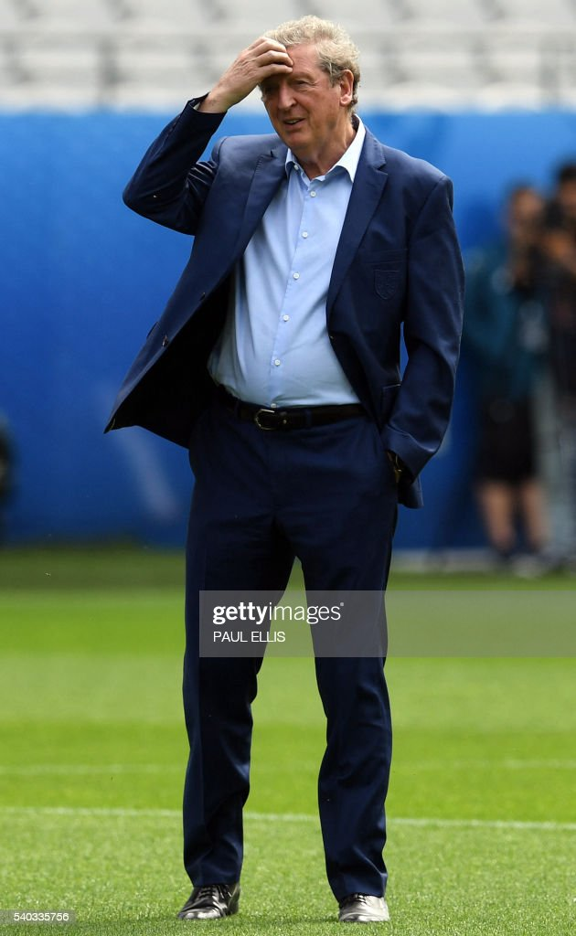 England manager Roy Hodgson stands on the pitch at the Bollaert-Delelis stadium in Lens on June 15, 2016 days before England take on Wales on June 16 in the Euro 2016 football tournament. / AFP / PAUL