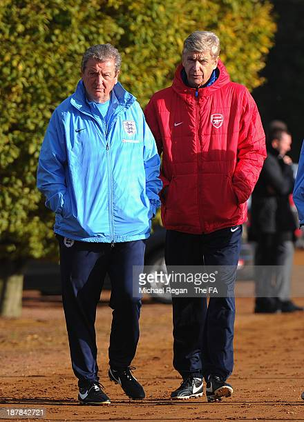 England manager Roy Hodgson stands with Arsenal manager Arsene Wenger during the England training session at London Colney on November 13, 2013 in St...