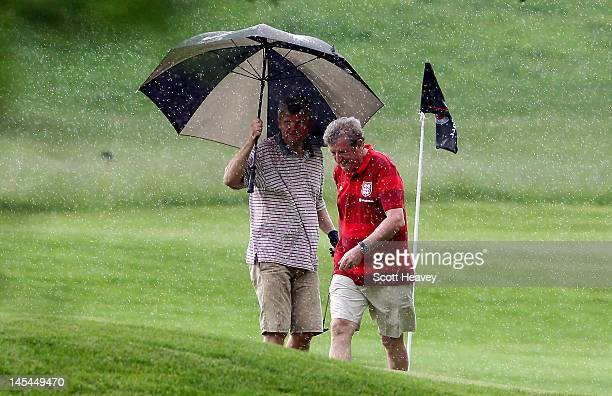 England manager Roy Hodgson with Adrian Chiles during a Vauxhall Golf Day for the England Football team at The Grove Hotel on May 30 2012 in Hertford...