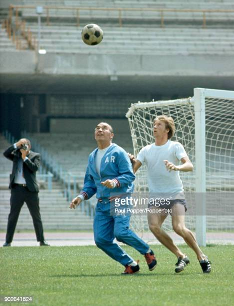 England manager Sir Alf Ramsey is shadowed by Manchester City's Colin Bell as the reigning World Champions prepare for their first match at the 1970...