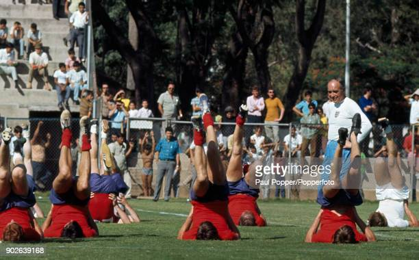 England manager Sir Alf Ramsey supervising the reigning World Champions as they prepare for their first match at the 1970 FIFA World Cup with a...