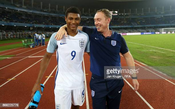 England manager Steve Cooper celebrates victory with Rhian Brewster during the FIFA U-17 World Cup India 2017 Semi Final match between Brazil and...