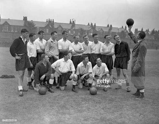England Manager Walter Winterbottom holds up a football to the Great Britain team unknown Bertie Peacock Peter Sillett Jack Kelsey John Charles...