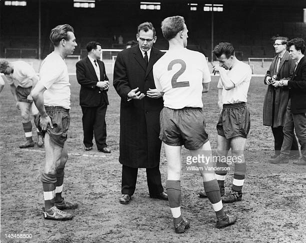 England manager Walter Winterbottom talks to members of the England football team in training at Highbury, London, for a match against Scotland, 8th...