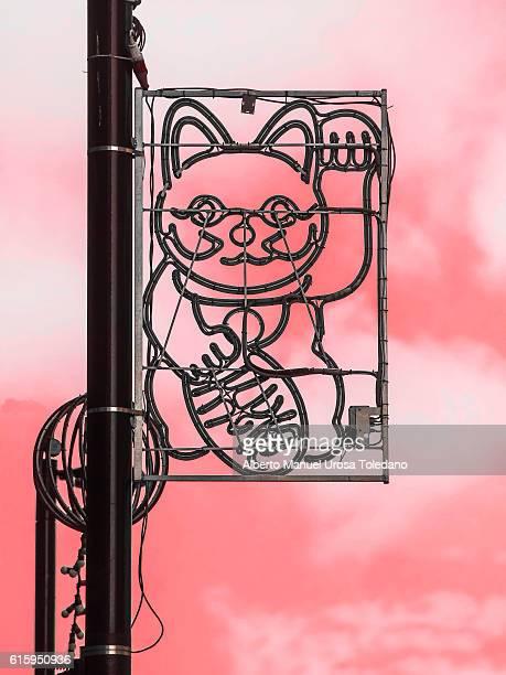 england, manchester, fortune cat - maneki neko stock photos and pictures