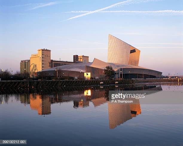 england, manchester, salford quays, buildings reflected in water, dawn - manchester england stock pictures, royalty-free photos & images