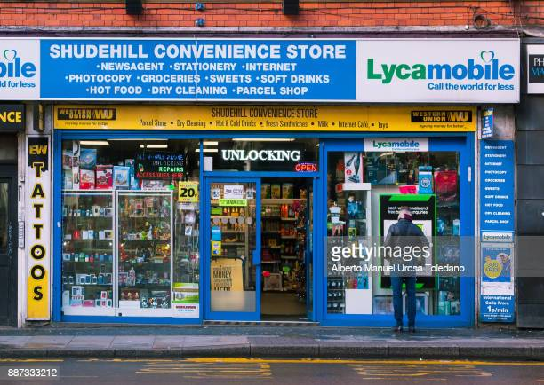 england, manchester, shudehill street, convenience store - north west england stock pictures, royalty-free photos & images