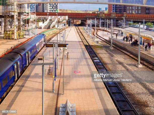 england, manchester, victoria train station, platform - victoria station manchester stock pictures, royalty-free photos & images