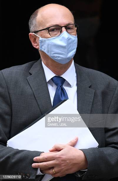 England Medical Director Professor Stephen Powis leaves 10 Downing Street in central London on October 12, 2020 after attending a public briefing on...