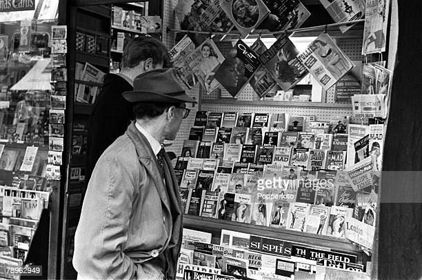 England Men are pictured looking into a Girlie shop window containing lurid books and magazines