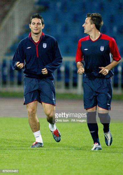 England midfielder and goal scorer against Wales, Frank Lampard and his Chelsea team-mate John Terry during a late training session at the Bakhramov...