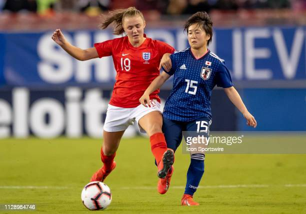 England midfielder Georgia Stanway holds back and Japan forward Yuka Momiki during the She Believes Cup match between the Japan and England on March...
