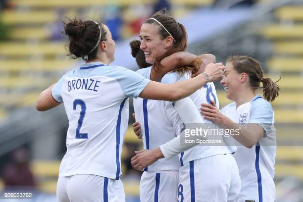 England midfielder Jill Scott celebrates with teammates after scoring a goal during the first half of the international game between England and...
