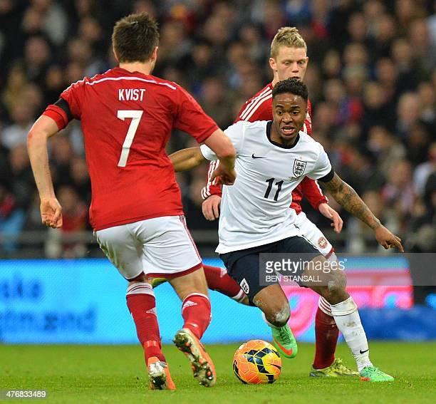 England midfielder Raheem Sterling takes on Denmark midfielder William Kvist during the international friendly football match between England and...