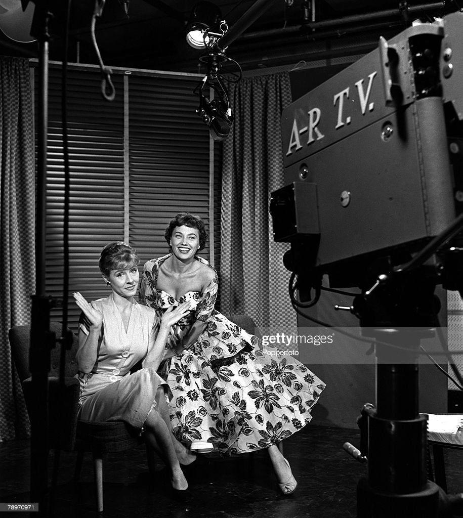 England, 1956, Muriel Young (right), the television continuity announcer for the new ITV television station, is pictured with Anne Valley as they are filmed by a television camera