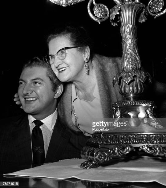 England Musician and pianist Liberace is pictured with his mother at a press reception