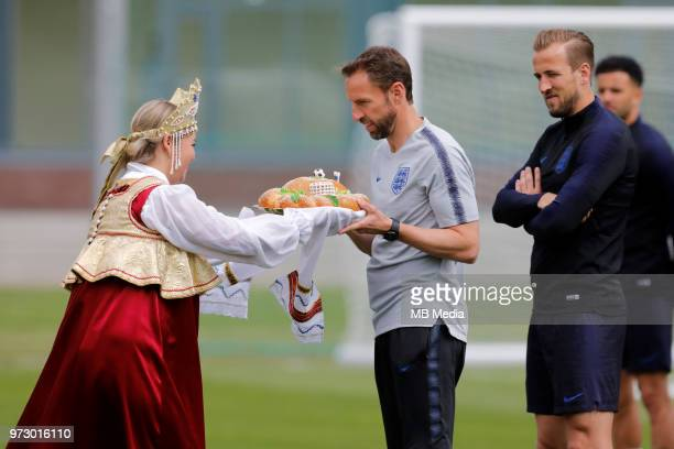 England national team head coach Gareth Southgate and Harry Kane accept gifts before an England national team training session ahead of the FIFA...