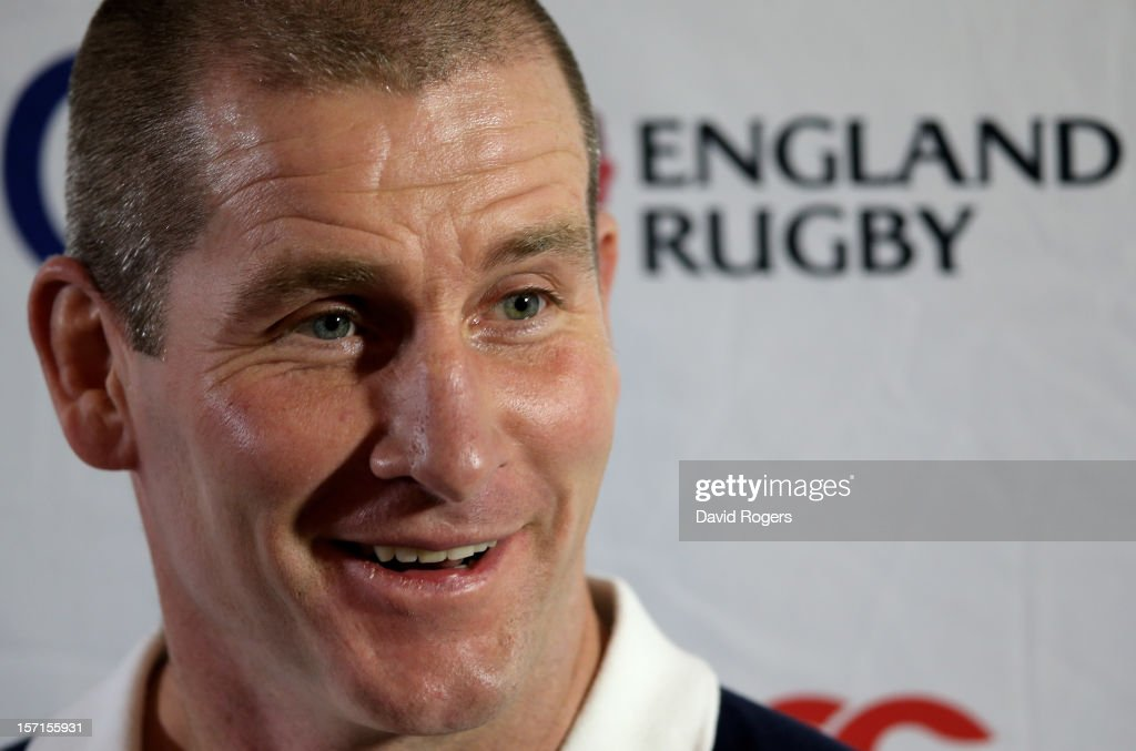 England nhead coach Stuart Lancaster speaks to the media following the England training session at Pennyhill Park on November 29, 2012 in Bagshot, England.