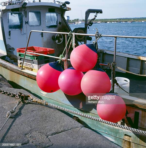 england, norfolk, fishing boat with pink fenders in harbour - richard drury stock pictures, royalty-free photos & images
