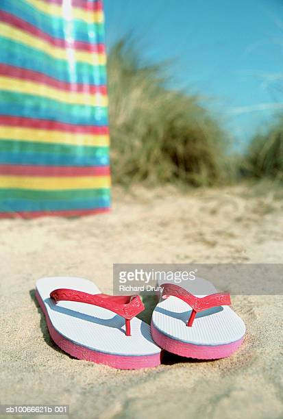 england, norfolk, hemsby, sandals on beach - richard drury stock pictures, royalty-free photos & images