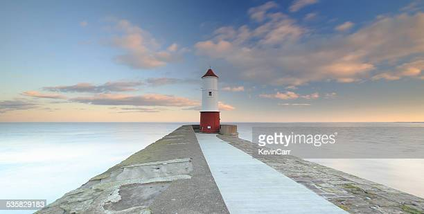 UK, England, North East England, Northumberland, Berwick Upon Tweed, View along footpath leading to lighthouse at end of pier