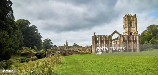 England NorthYorkshire the ruins of the 12th century Cistercian Abbey known as Fountains Abbey one of the finest examples of monastic architecture in...