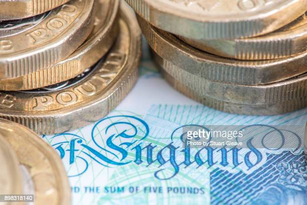 """""""england"""" on english currency (£5 note) - wages stock photos and pictures"""
